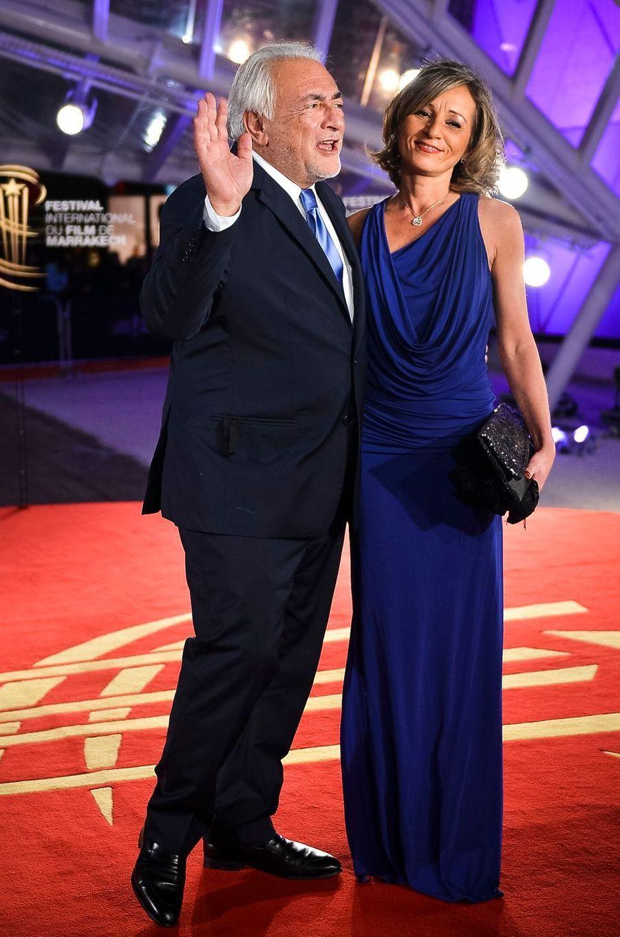 Dominique Strauss-Kahn au bras de sa compagne Myriam L'Aouffir.