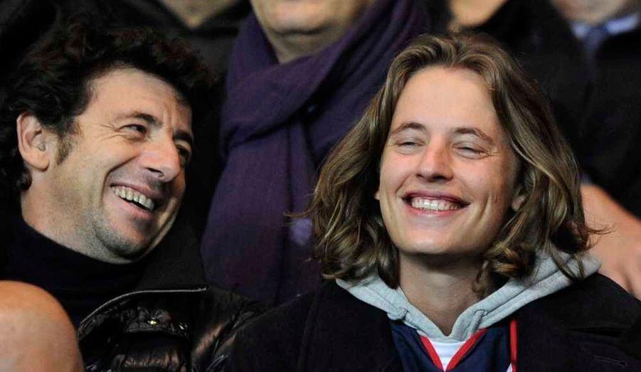 Le fils de Nicolas Sarkozy, Pierre, et Patrick Bruel au match de football opposant le Paris Saint-Germain et l'Olympique de Marseille à Paris.