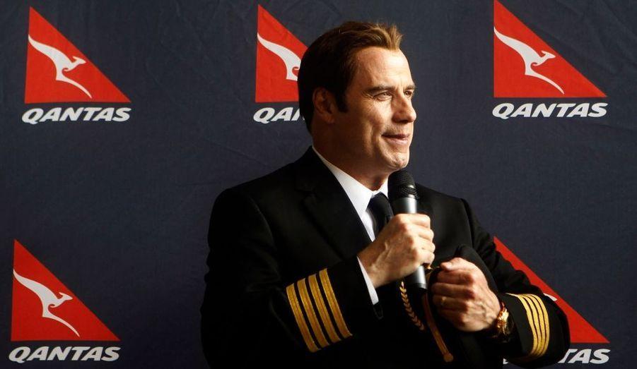 John Travolta joue les VIP de luxe pour le 90e anniversaire de la compagnie aérienne Qantas.