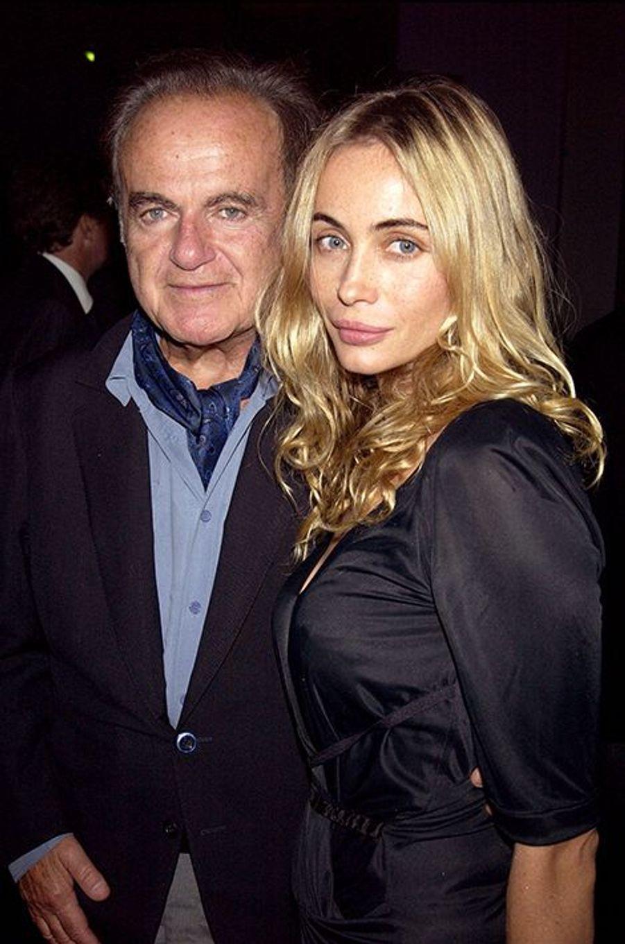 """Guy et Emmanuelle Béart à Paris en 2003. Le binôme assistait à l'événement """"Sony Dream World"""" au Palais des Congrès."""