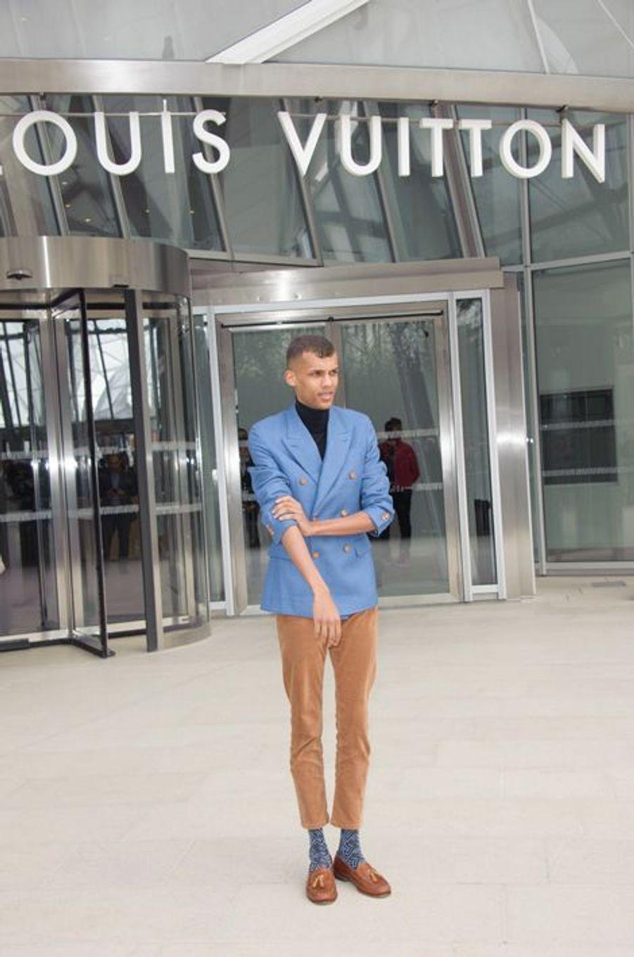 Stromae lors de sa dernière apparition au défilé Louis Vuitton du 11 mars dernier