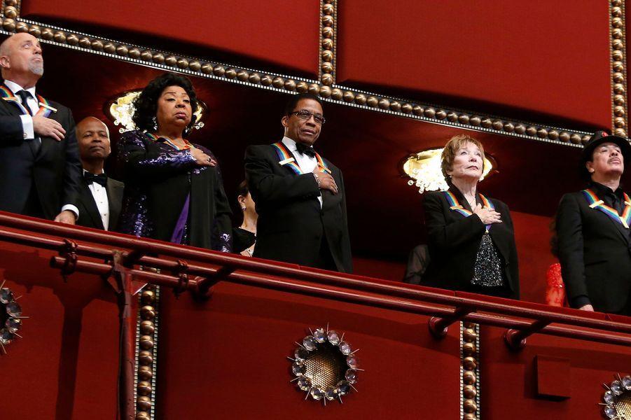 Billy Joel, Martina Arroyo, Herbie Hancock, et Shirley MacLaine, Carlos Santana