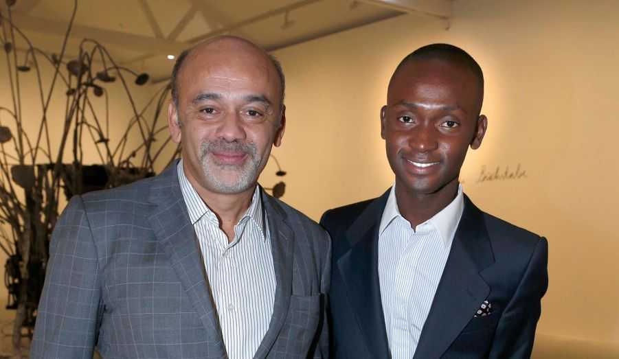 Christian Louboutin et Alpha, un de ses collaborateurs au studio de design.