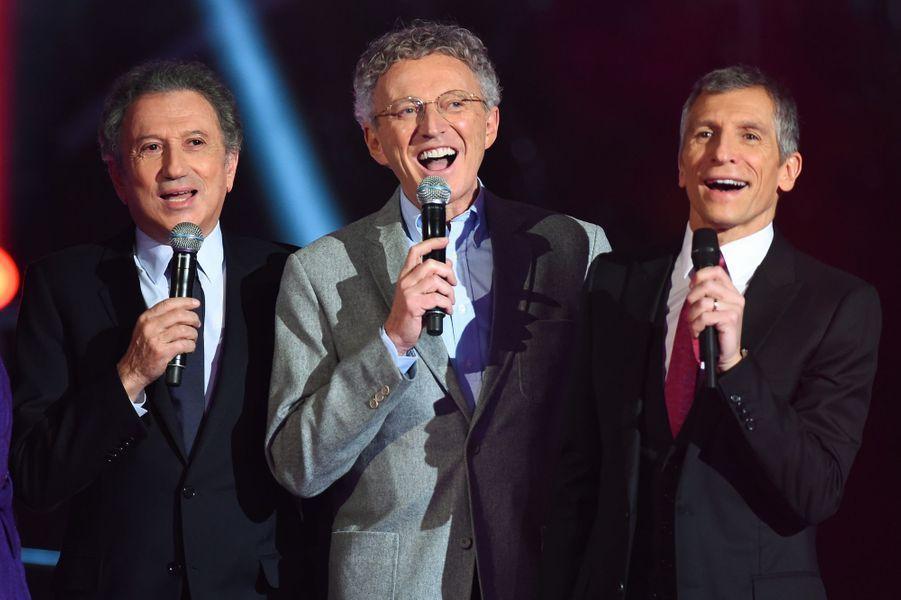 Michel Drucker, Nelson Montfort et Nagui au Téléthon 2014 à Paris, le 6 décembre 2014