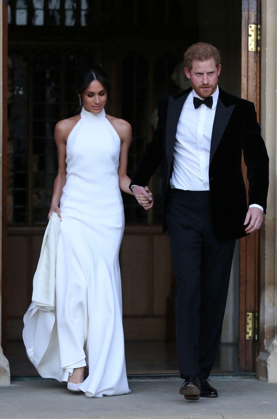 Meghan Markle, dans sa superbe robe du soir Stella McCartney, et le prince Harry, le jour de leur mariage, le 19 mai 2018