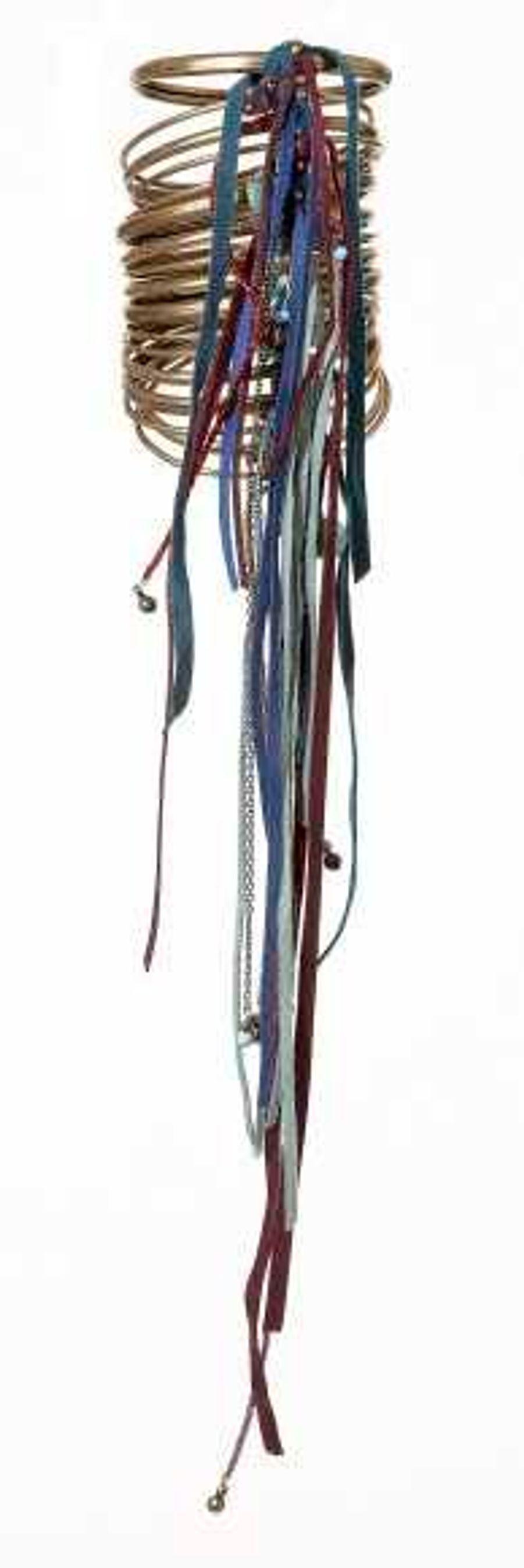 Manchette en métal et franges, Césarée, 300€