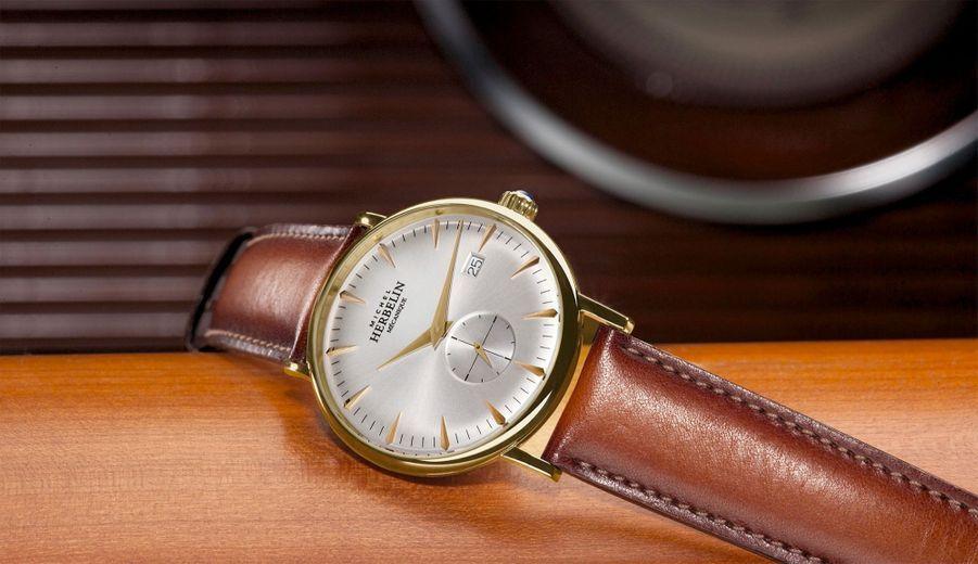 Vintage : Inspiration 1947 en acier plaqué or jaune, 40 mm, mouvement à remontage manuel, bracelet en cuir. Michel Herbelin, 1 450 €.