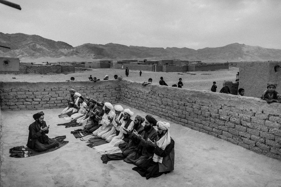 Afghan refugees pray in a mosque in Maslkh camp in the outskirt of Herat city, Afghanistan