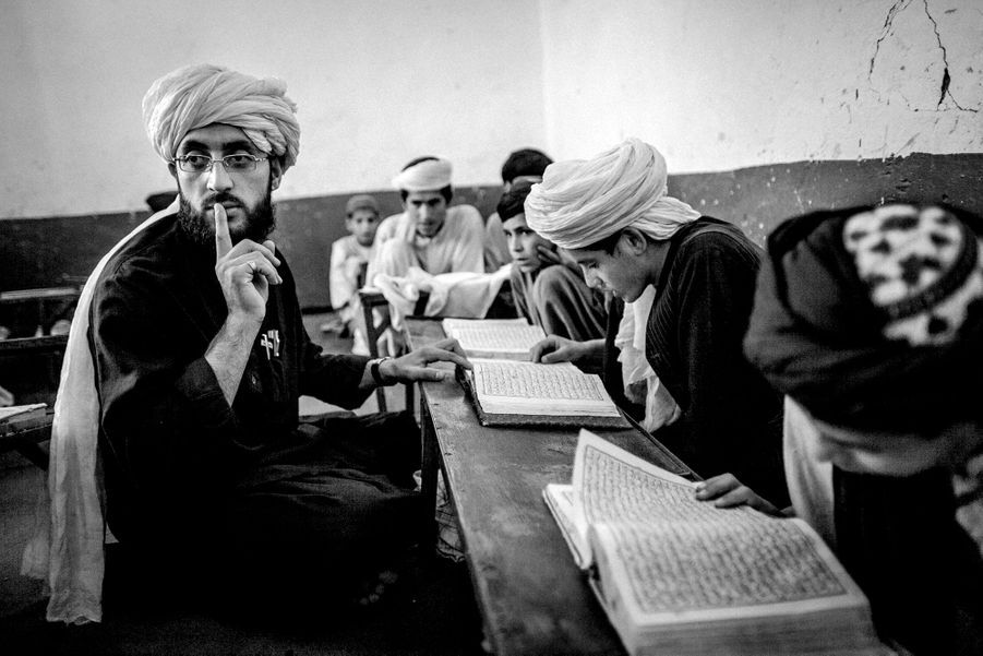 Afghan boys attend their Quran study sessions at the Islami Noor religious school in Kandahar, Afghanistan.