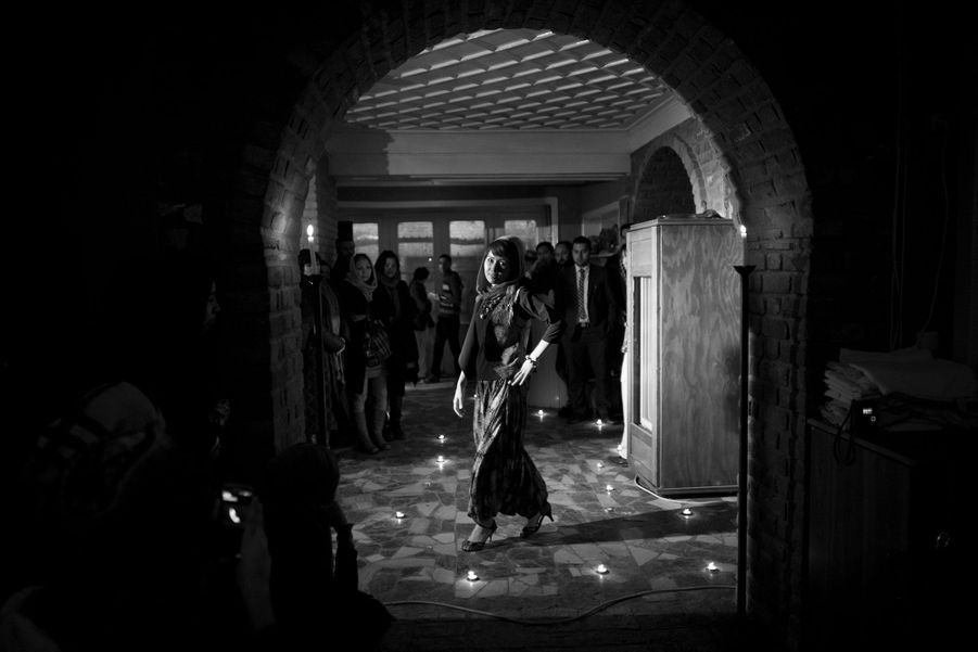 An Afghan girl models from 'Young Women For Change' during her fashion show in Kabul.