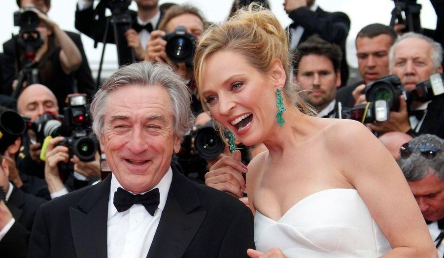 C'est parti ! Le 64e Festival de Cannes s'ouvre avec une première montée des marches très glamour. Le jury - notamment représenté par la resplendissante Uma Thurman et les très élégants Robert de Niro et Jude Law - est venu assisté à la projection de «Minuit à Paris» (hors-compétition) de Woody Allen, qui était accompagné d'une belle partie de son casting : Michael Sheen, Rachel McAdams, Owen Wilson, Lea Seydoux et Adrien Brody...