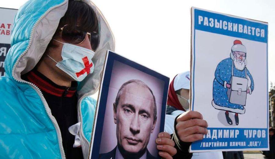 Des manifestations masqués protestent contre les résultats de l'élection législatives russes à Stavropol.
