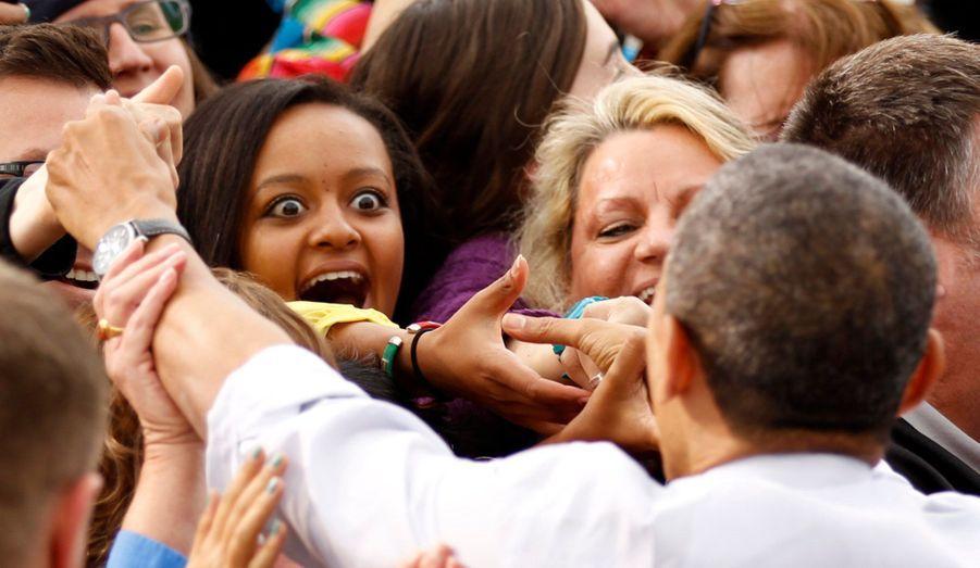 Une jeune femme ne cache pas son enthousiasme lors d'un meeting de Barack Obama à Denver, dans le Colorado.