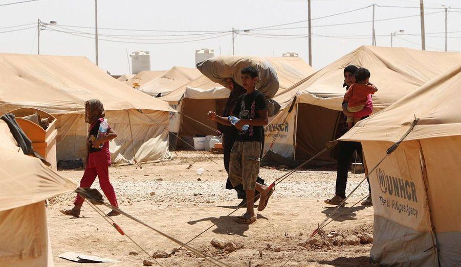 Ils ont fuit les viles meurtries de Syrie. Ces réfugiés arrivent dans le camp de fortune de la ville de Mafrak, en Jordanie.