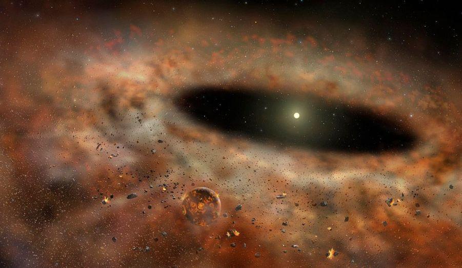 Voici une conceptualisation artistique du système solaire TYC 8241 2652, qui intrigue de nombreux astronomes. Le disque brillant de poussière disposé autour d'une étoile-soleil a soudainement disparu, ce qui laisse les scientifiques sans explication valable.