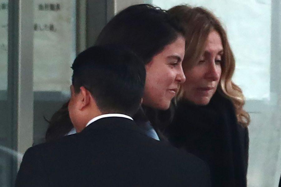 Carole Ghosn (à dr.), l'épouse de Carlos Ghosn, et Caroline, la fille de l'ex-P-DG, mercredi à Tokyo.
