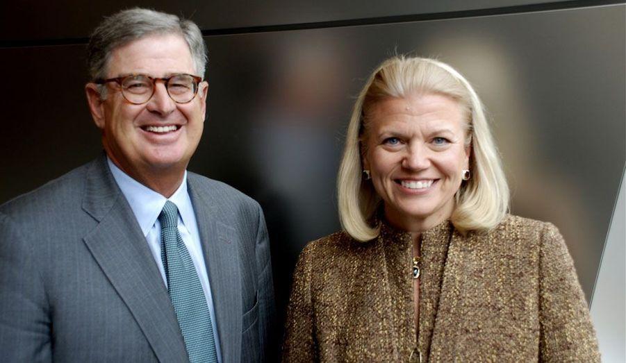 Ici photographiée aux côtés de son prédécesseur Sam Palmisano, Virginia Rometty, 54 ans, a pris la tête de IBM en janvier dernier après avoir passé 30 ans dans le groupe informatique.