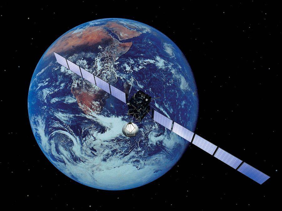 Vue d'artiste de la sonde Rosetta lorsqu'elle est passée devant la Terre, après son lancement.