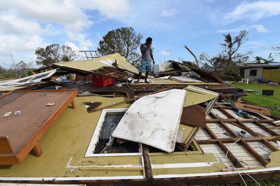 Local resident Adrian Banga looks at his home destroyed by Cyclone Pam in Port Vila, the capital city of the Pacific island nation of Vanuatu