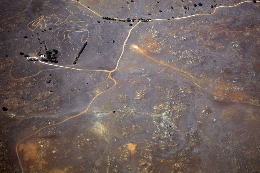 Tracks and roads can be seen near a farmhouse in drought-affected farming areas located in the eastern region of the state of South Australia