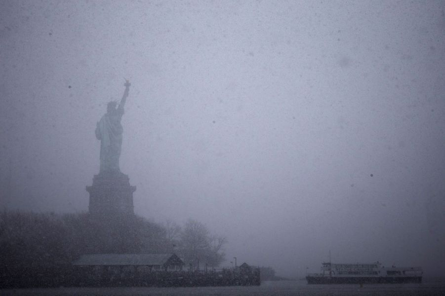 The Statue of Liberty is seen during a snowfall in New York