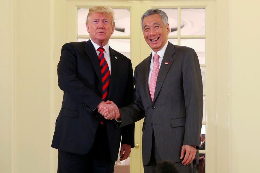 Donald Trump et le Premier ministre singapourienLee Hsien Loongà Singapour, le 11 juin 2018.