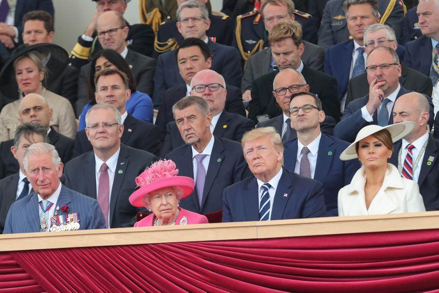 Au premier rang, le prince Charles, Elizabeth II, Donald et Melania Trump.