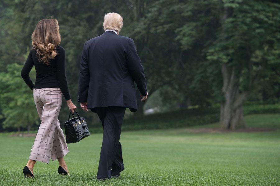 Melania et Donald Trump quittant la Maison Blanche, le 5 juillet 2017.