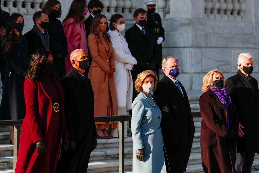 Michelle et Barack Obama, Laura et George W. Bush, Hillary et Bill Clintonau cimetière national d'Arlington, le 20 janvier 2021.