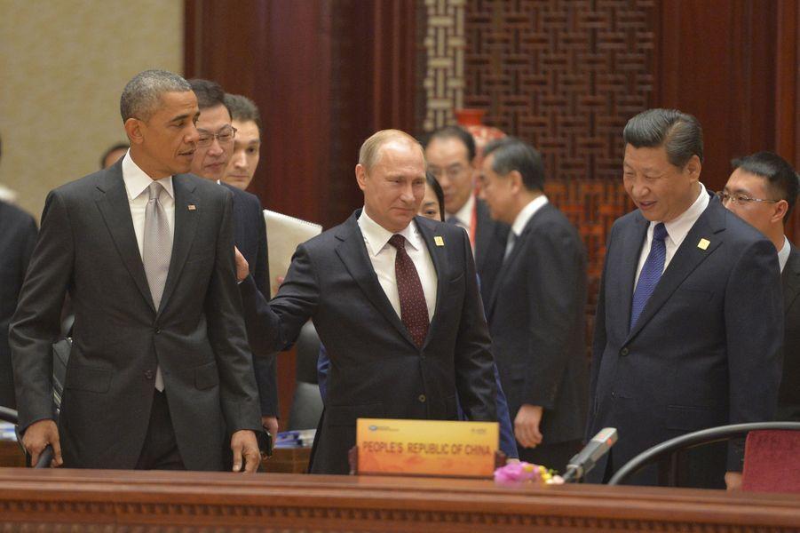 Barack Obama, Vladimir Poutine et Xi Jinpingau sommet de laCoopérationéconomique des pays d'Asie-Pacifique à Pékin (Chine), le 11 novembre 2014.