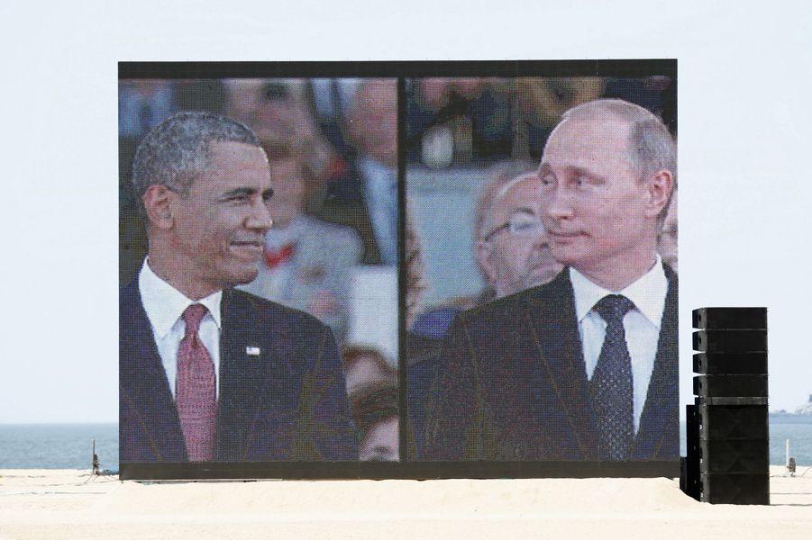 Barack Obama et Vladimir Poutine lors des commémorations pour les 70 ans du Débarquement à Ouistreham, le 6 juin 2014.