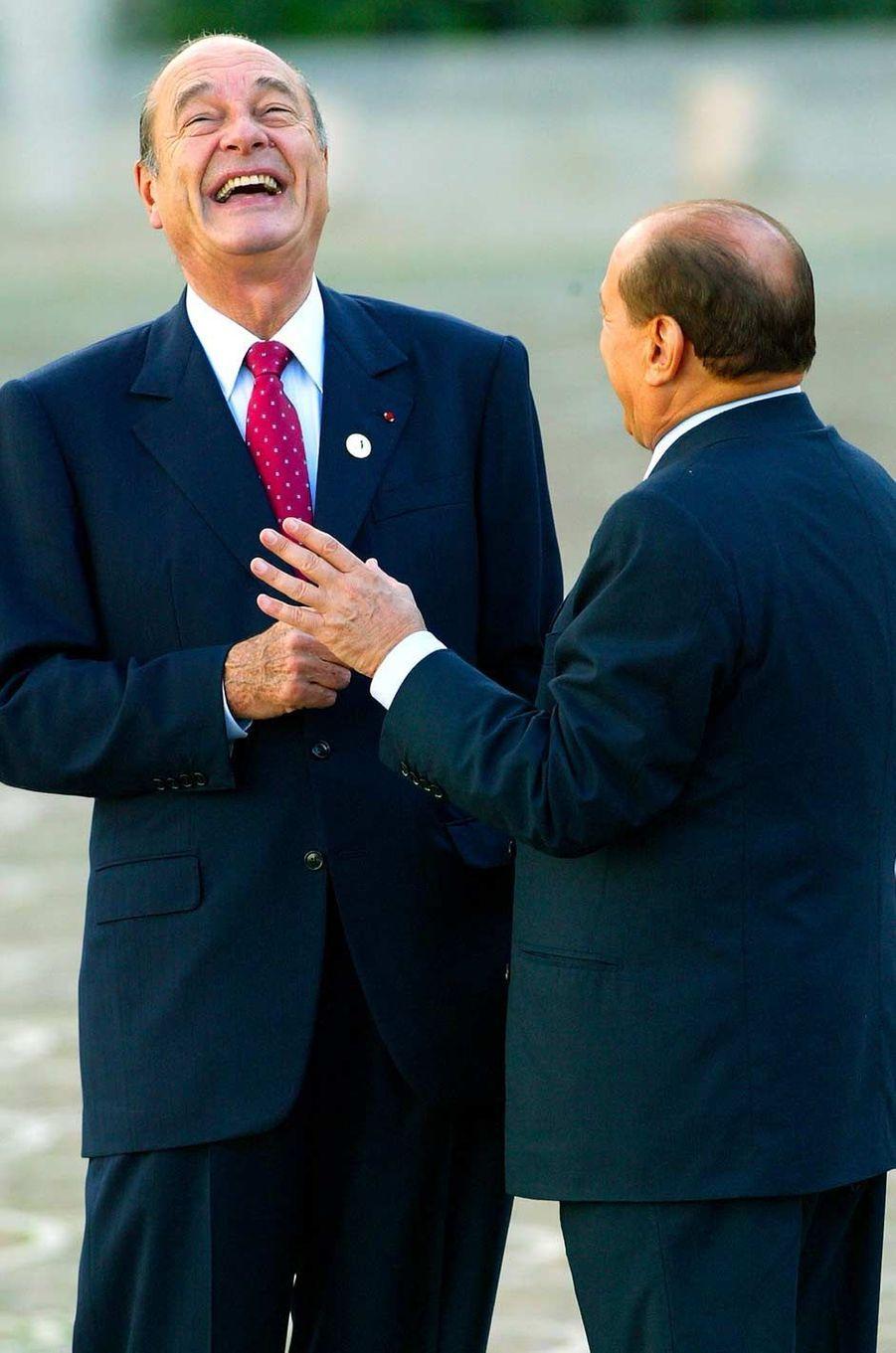 Jacques Chirac et le Premier ministre italien Silvio Berlusconi à Rome, en octobre 2003.