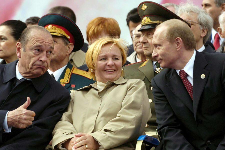 Jacques Chirac, Lyudmila et Vladimir Poutine à Moscou, en mai 2005.