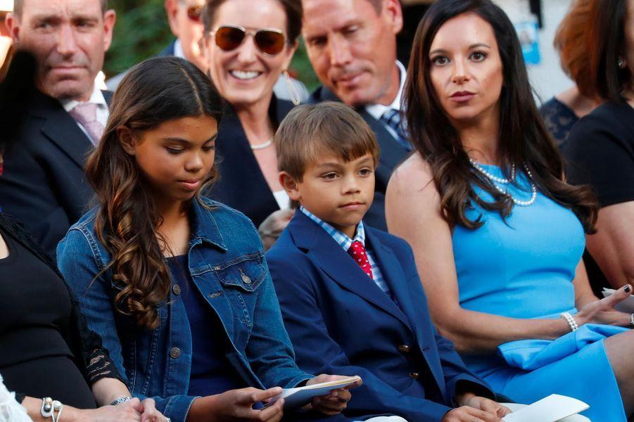 Sam et Charlie, les enfants de Tiger Woods, avec sa compagneErica Herman à la Maison-Blanche, le 6 mai 2019.