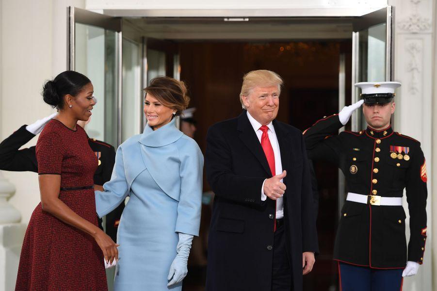 Michelle Obama, Melania Trump et Donald Trump à la Maison Blanche, le 20 janvier 2017.