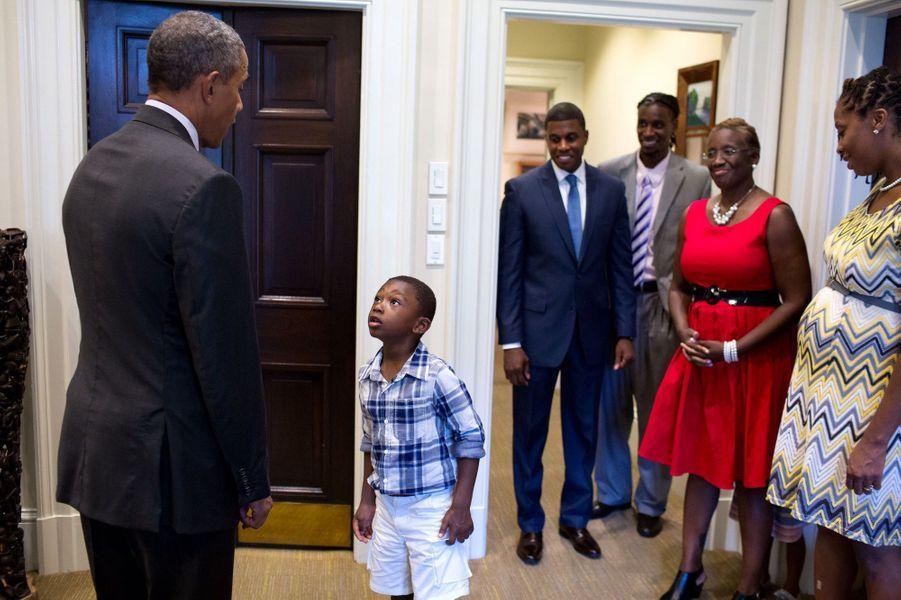 Malik, le neveu de l'ancien vice-secrétaire général de la Maison Blanche Maurice Owens, n'en revient pas de croiser Barack Obama, le 4 septembre 2015.