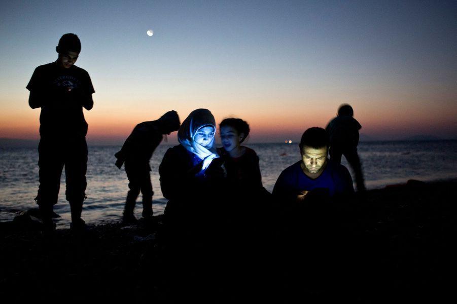 12 août. Des migrants sur la plage de l'île de Kos, en Grèce
