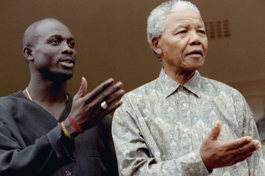 George Weah et Nelson Mandela, en janvier 1996.