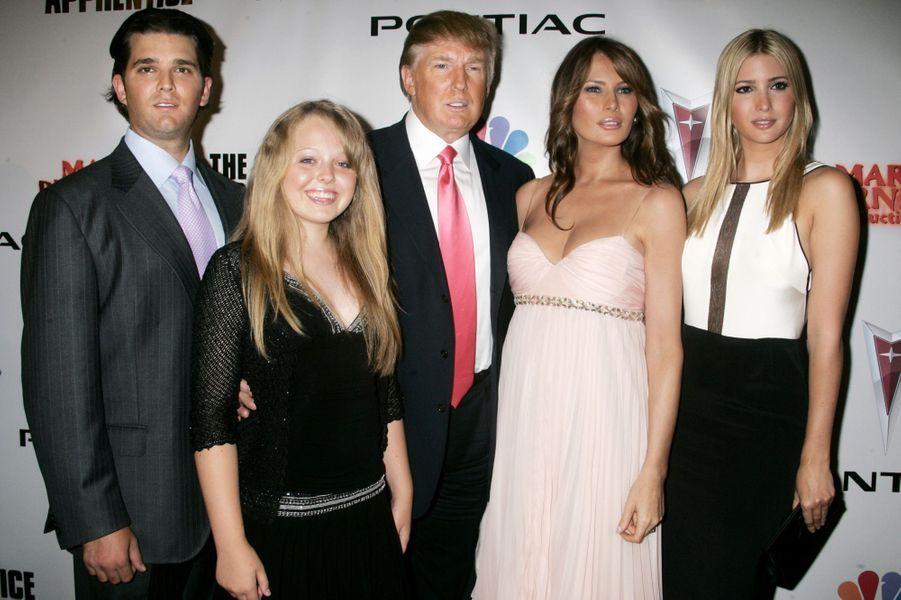 Donald Trump Jr, Tiffany Trump, Donald Trump, Melania Trump et Ivanka Trump, en juin 2006.