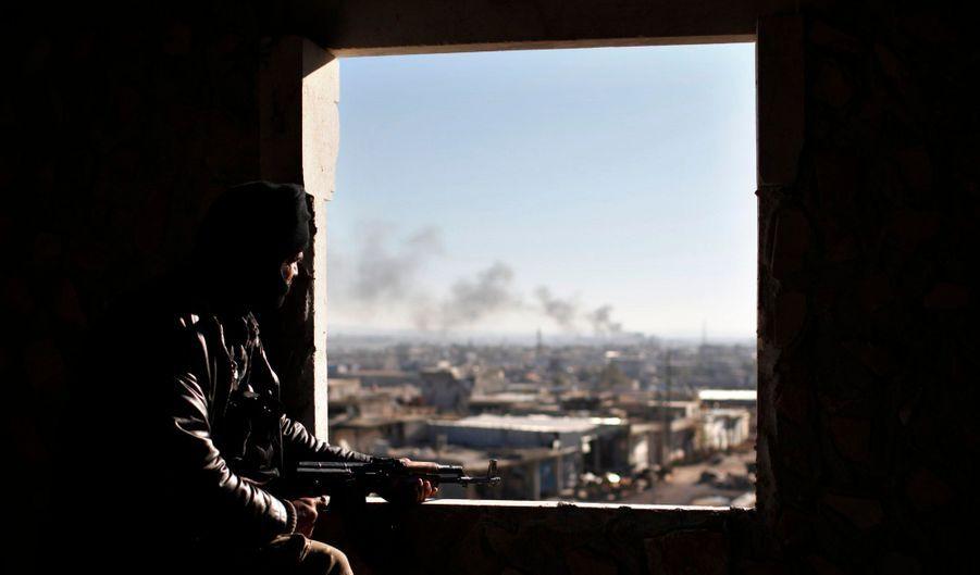 Alors qu'on le disait exsangue à la fin de l'année 2011, le régime de Bachar Al-Assad tient toujours le pouvoir en Syrie, malgré la résistance des rebelles, comme ici à Alep.