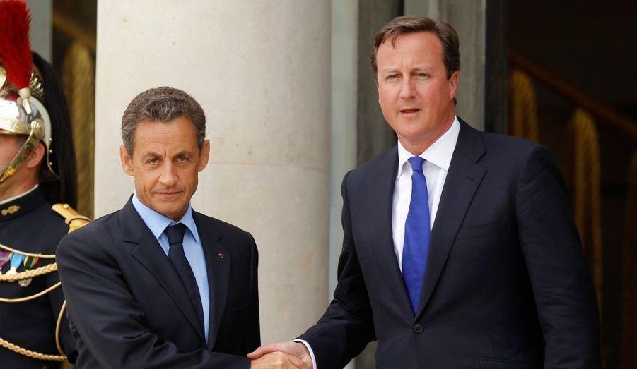 En présence de David Cameron (Premier ministre anglais)