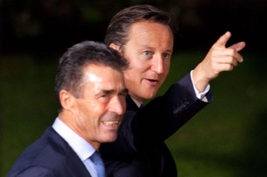 Le secrétaire général de l'Alliance atlantique Anders Fogh Rasmussen et le Premier ministre britannique David Cameron