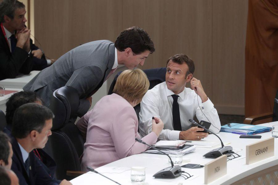 Justin Trudeau, Angela Merkel et Emmanuel Macron.