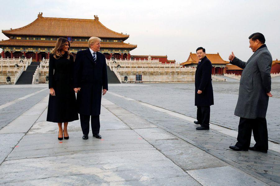 Melania et Donald Trump à la Cité Interditeavec le président chinois Xi Jinping, le 8 novembre 2017.