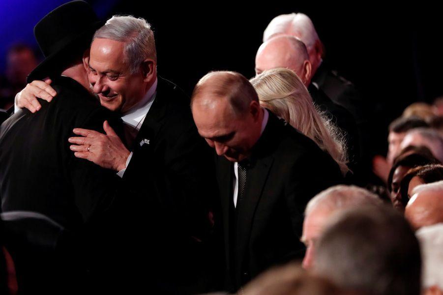 Le rabbin, Israel Meir Lau,président du Mémorial de Yad Vashem,Benjamin Netanyahu et Vladimir Poutine.