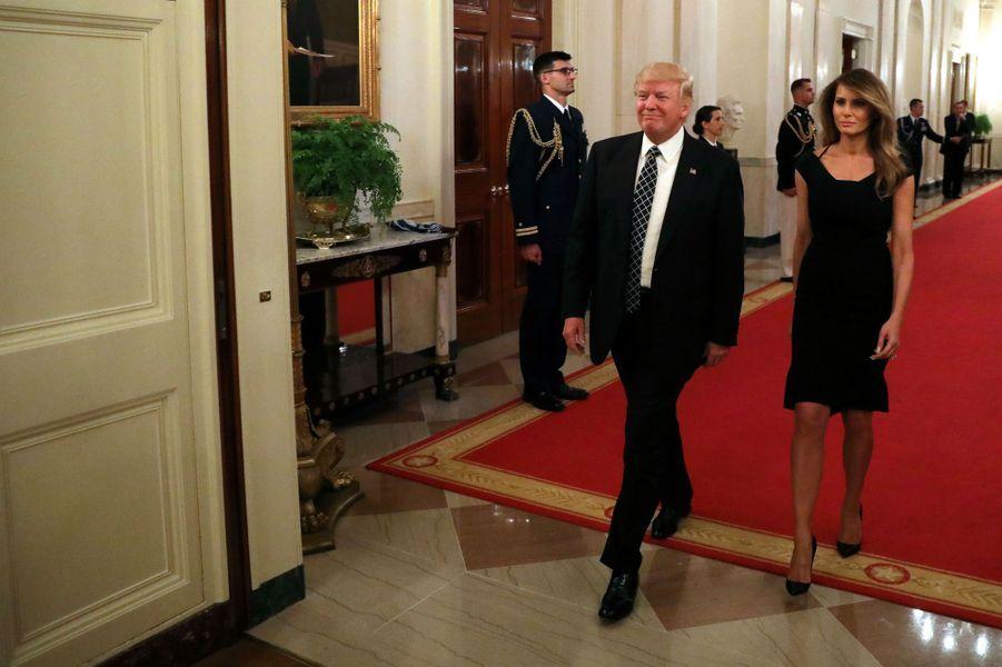 Donald Trump et Melania Trump à la Maison Blanche pour un événement avec des sénateurs, le 28 mars 2017.A voir : Invisible à New York, Melania Trump est de retour à la Maison Blanche