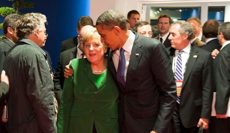 Avec Angela Merkel, la Chancelière allemande.