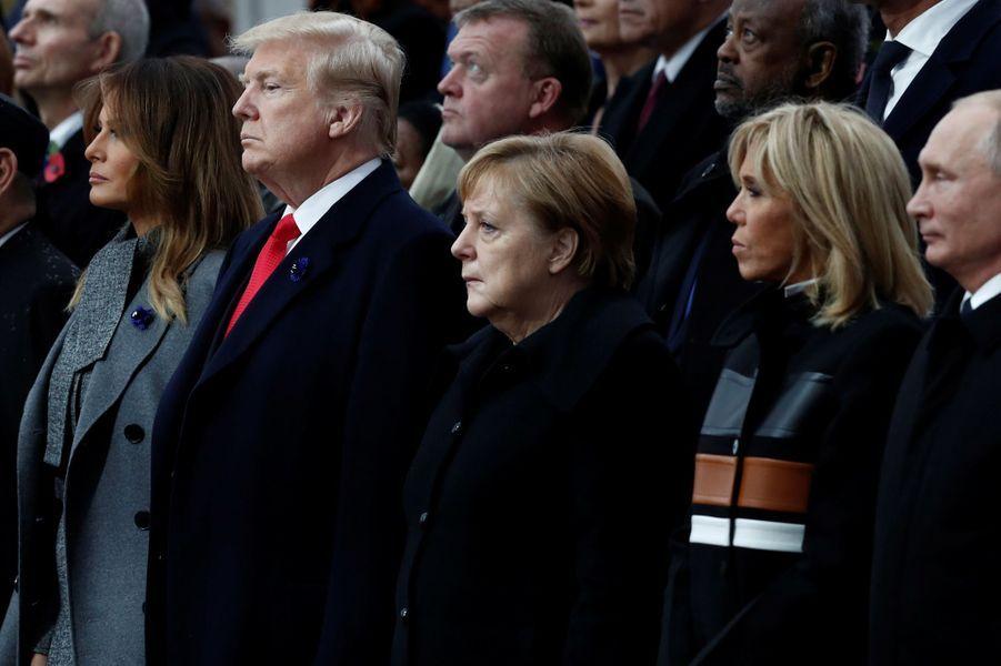 Donald Trump et son épouse Melania, Angela Merkel, Brigitte Macron et Vladimir Poutine à la cérémonie.