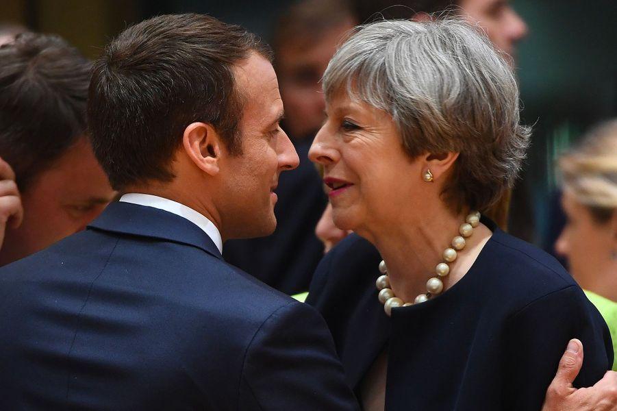Emmanuel Macron, Theresa May.
