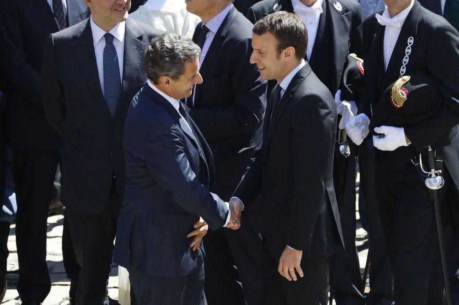 Nicolas Sarkozy et Emmanuel Macron à l'hommage national rendu à Michel Rocard aux Invalides, le 7 juillet 2016.